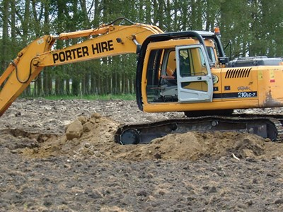 Farmers use diggers to mix or turn soil.