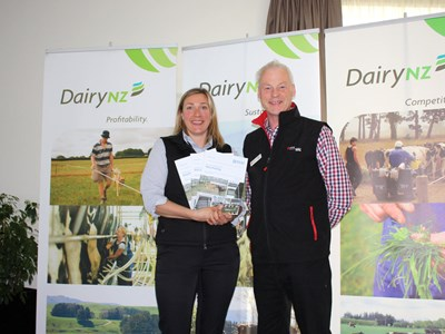 DairyNZ developer Helen Thoday and Rex Corlett of the Institute of Professional Engineers with the new Practice Note on dairy housing.
