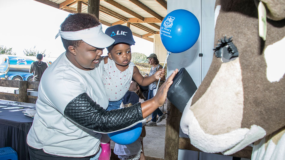 Nokhu Jena with Angel (from Hamilton) give Rosie the cow a high five.