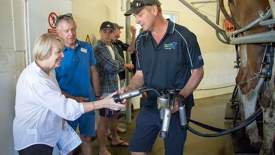 Visitors enjoy their tour of the milking shed at Owl Farm Open Day.