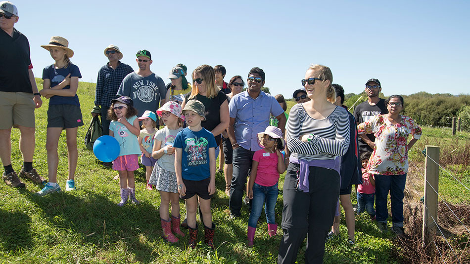 Visitors listen to Owl Farm's Louise Cook (not pictured) as she talks about the benefits of the wetland.