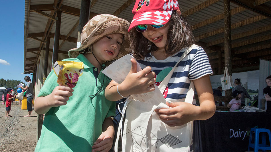 William and Emelie McAdam (from Hamilton) explore their Rosie goody bags from DairyNZ.
